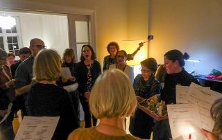Members sing Christmas Carols