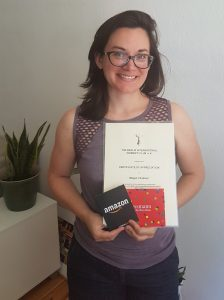 Megan with her award certificate and gift vouchers