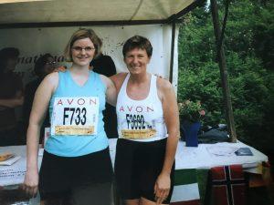 Julia & Lucy Avon 10km Race in front of BIWC's stall